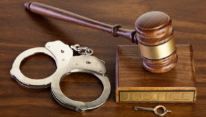 photo of gavel and handcuffs